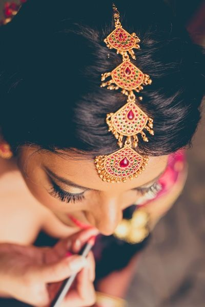 Last minute touches! The bride getting her touchup - pretty #indianBride #indianwedding #makeup | Curated by Witty Vows - The ultimate guide for the Indian Bride | www.wittyvows.com