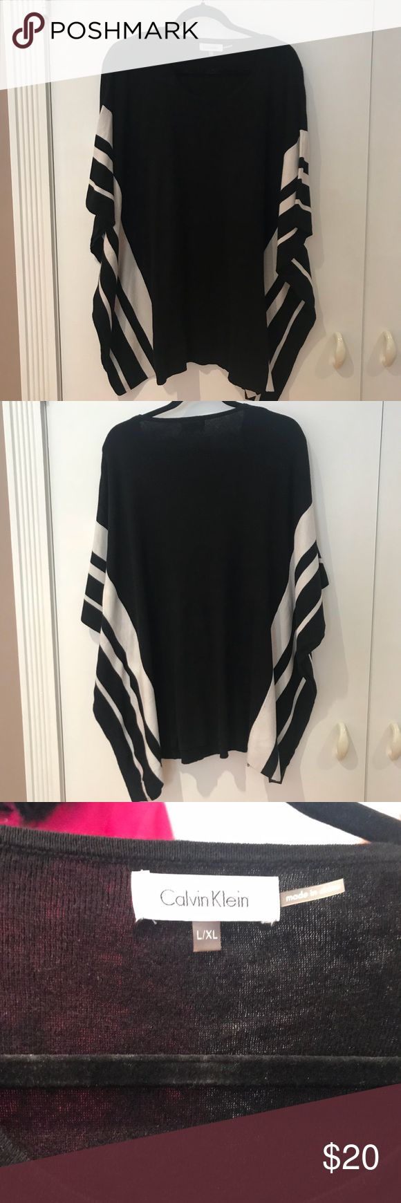 Calvin Klein poncho w/ striped details on the side Calvin Klein L/xl Black poncho top with cream striped details on the side. Perfect with a pair of leggings and a gray pair of boots. Fun, easy and very chic!  Calvin Klein Sweaters Shrugs & Ponchos