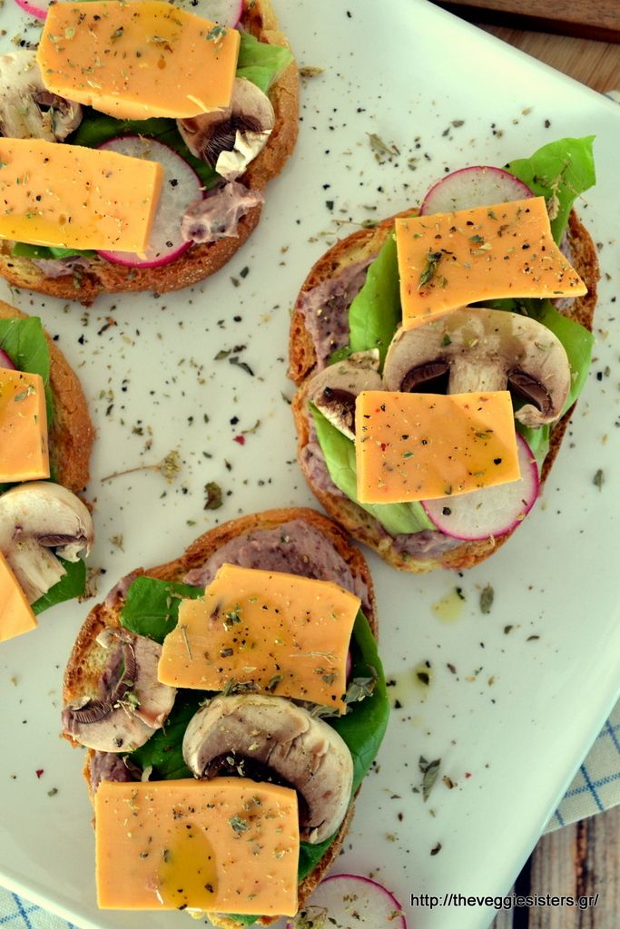 Vegan Sandwitch with cheese, veggies and red bean roasted garlic hummus