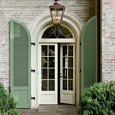 Beautiful limestone entry with french doors and leaded for Green french doors