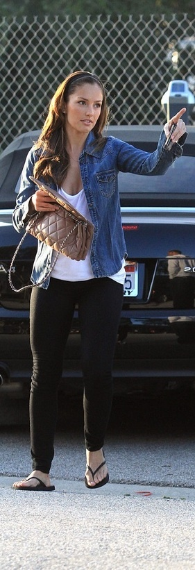 Hair back, with a jean jacket/denim button-down with a white tee and leggings