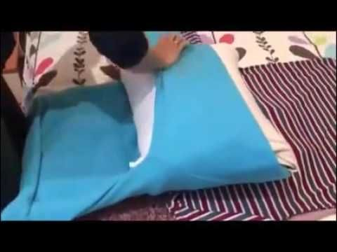 This revolutionary space saving method shows how to fold clothing in suitcase - YouTube