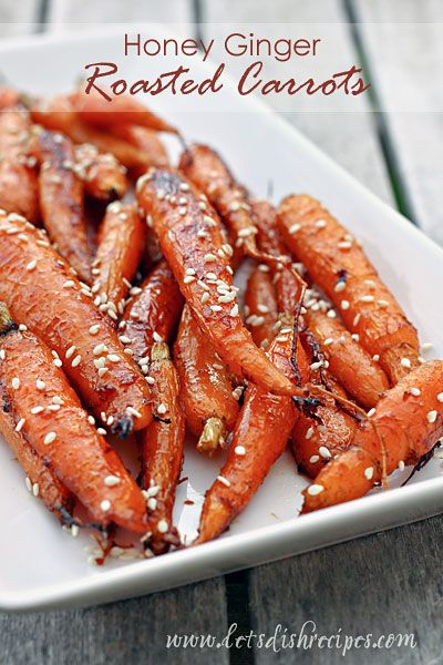 Honey Ginger Roasted Carrots | Fresh carrots roasted in a sweet honey and ginger glazed, then finished off with a sprinkling of sesame seeds. The perfect side dish for any dinner!