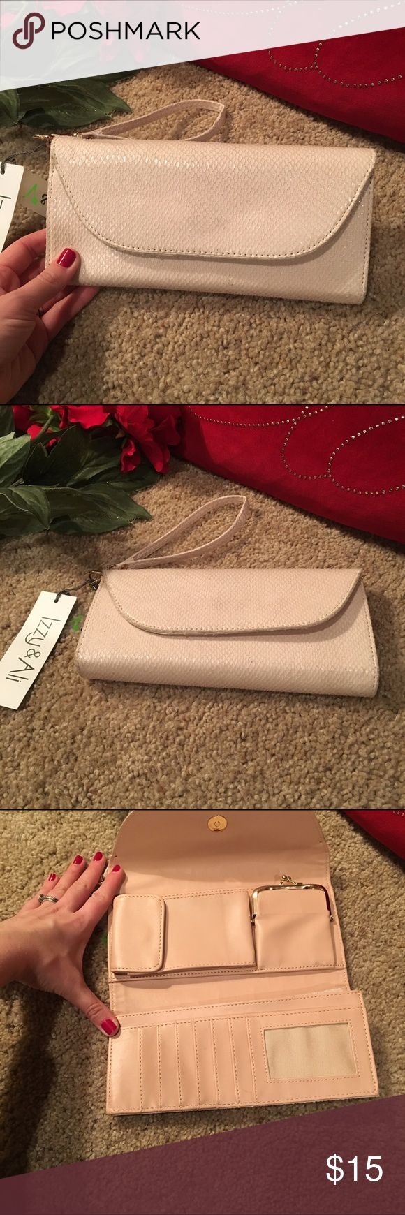 Nude clutch bag Nude clutch bag/wallet. NWT! Has areas for cash, credit cards, change and a small phone pocket. I tried to fit my iPhone 6s with otterbox case and it did not fit. So it would probably have to be a smaller iPhone to fit in there. Bags Clutches & Wristlets
