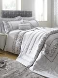 Amelie Crushed Velvet Panel Duvet Cover Set in Double, King and Super King sizes – Silver The Amelie bedding collection revels in luxury looks, with shimmering sheets and indulgent colour schemes combining to create a striking new look in any space. In double, king and super king sizes, this silver duvet cover and pillowcase set sees a base of matt satin complemented by a striking crushed velvet panel. The two sections are separated by a strip of sparkling diamantes, giving the set an extra…