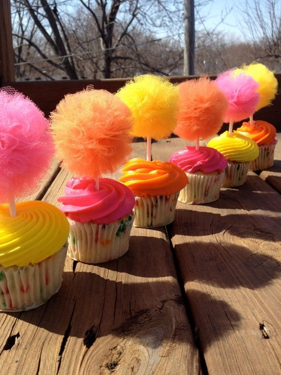 "How to make your own tulle ball cupcake toppers - maybe a ""dr. suess party"" to be the trees in the lorax orrrrr princess or candyland theme. similar effect can be achieved with other party supplies"