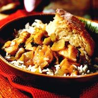 Chicken Etouffee - A spicy and delicious Cajun stew traditionally made with crawfish, vegetables and a dark roux. Étouffée is usually served over rice. The word comes from the French étouffer, which means to smother.  Pronunciation: ay-too-FAY