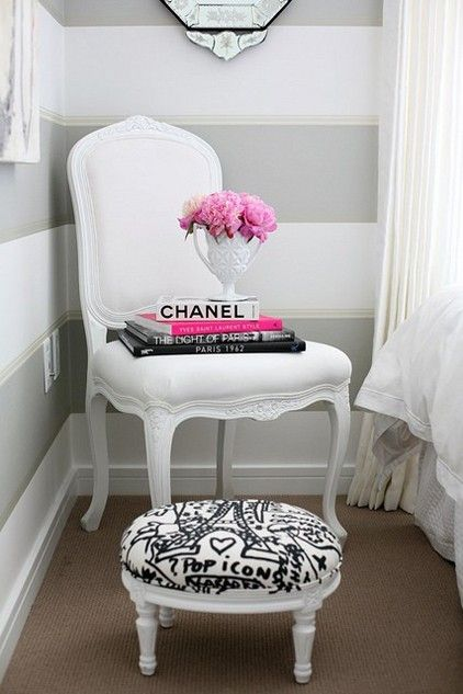 contrast hues..love the black and white stool, pink peonies echoing neon pink book, and light grey wide stripe wallpaper