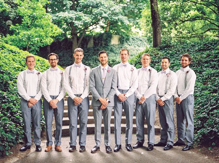 the groom and his groomsmen. grey suit. suspenders with bow ties: Bridal Bliss Wedding