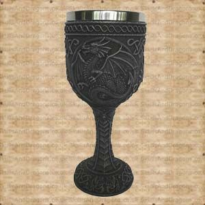 A gothic goblet with a dragon design. This dragon goblet has a removable stainless steel insert for ease of cleaning measuring approximately 6cms deep with a diameter of 6cms. The Theobalds Goblet brought to the Skulls and Dragons drinkware range by Nemesis Now.    Height : 18 cm    Width : 7 cm    Length : 7 cm    Weight : 400.00g    Made from resin, stainless steel    Ref : SDNEM5410   Was 9.99 Now Only £5.00