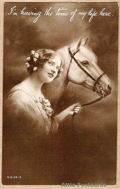 Vintage real photo postcard of a young woman and a horse.