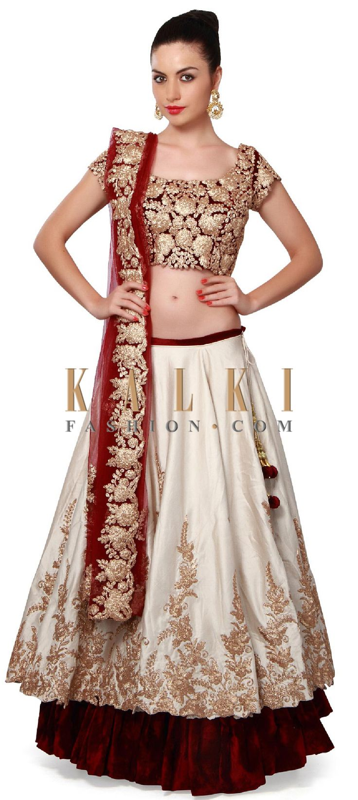 Buy Online from the link below. We ship worldwide (Free Shipping over US$100). Product SKU - 300859. Product Price - $1,399.00. Product link - http://www.kalkifashion.com/cream-and-wine-lehenga-adorn-in-zari-embroidery-only-on-kalki.html