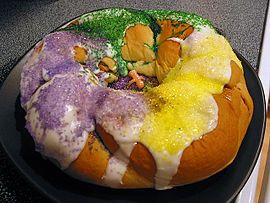 This is a King Cake. Jo taught me about it. During Mardis Gras you bake a cake with a plastic baby inside and whoever gets the piece with the baby wins a prize or has to host the next Mardis Gras party.