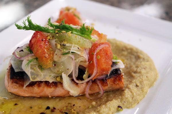 Salmon fillet with garlic eggplant, citrus salad and pistachio nuts