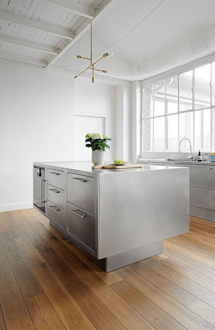 Albimis all-stainless steel kitchen in a Paris loft by Festen Architecture | Remodelista