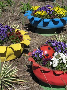 Outdoor Planter Projects:  Painted old Tires.  My Granny had several of these around her yard in the '70s.