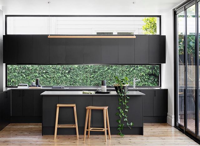 Dark cabinetry with timber. Window splashback. Boom!