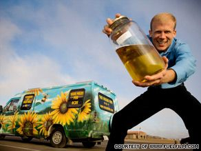 "Director Josh Tickell holds a jar of bio-diesel ijn front of his ""Veggie Van."" - http://edition.cnn.com/2009/TECH/science/09/25/going.green.fuel.film/index.html"