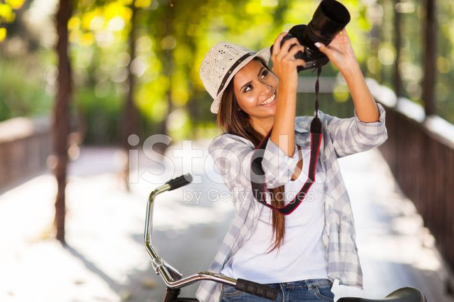 young woman taking photos outdoors