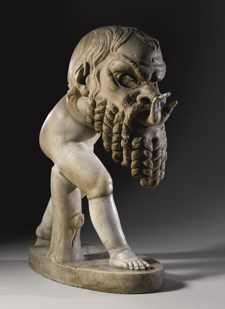 A MARBLE FIGURE OF A YOUNG SATYR WEARING A THEATER MASK OF SILENUS, ROMAN IMPERIAL, CIRCA 1ST CENTURY A.D., WITH RESTORATIONS BY ALESSANDRO ALGARDI, 1628