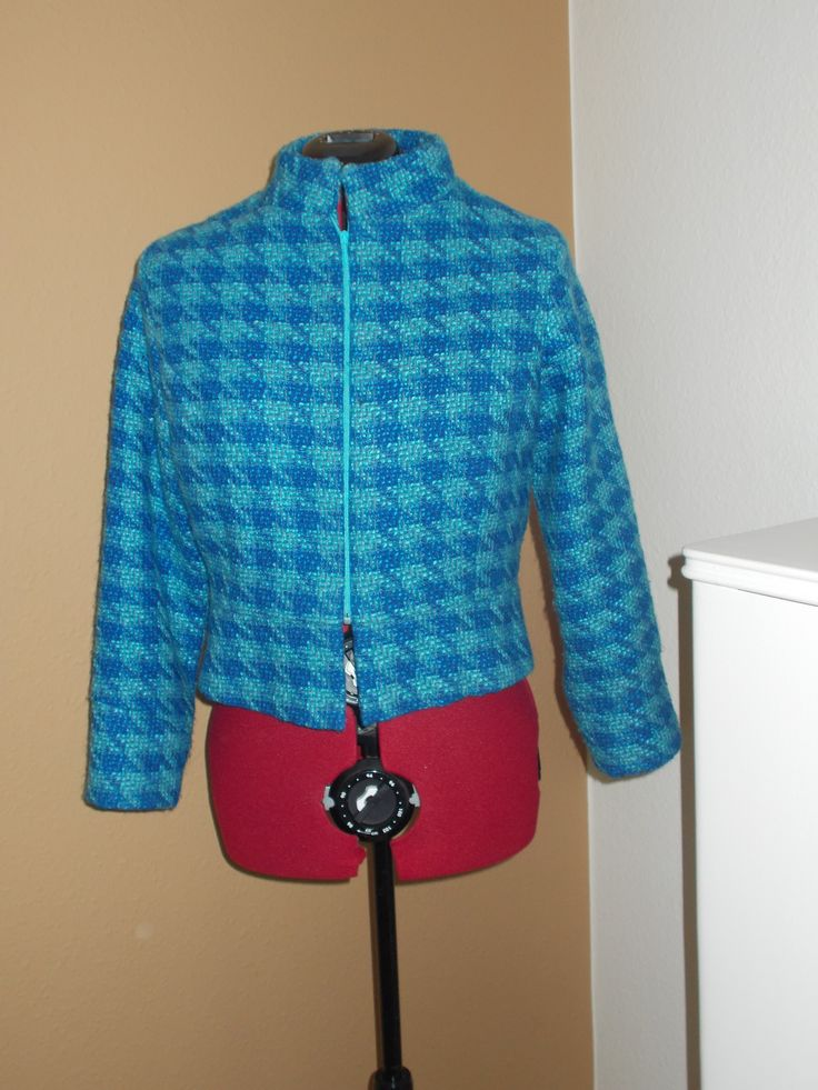Modified motorcycle jacket or modern Chanel? Who cares - the wool fabric is lush and the is color i great!!