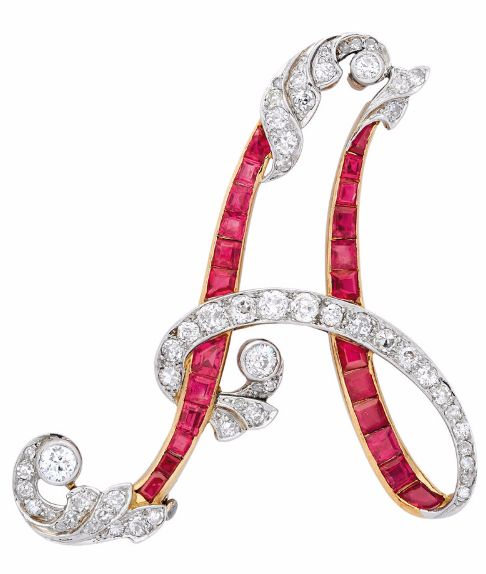 A Ruby and Diamond Brooch, circa 1920 Depicting the letter A, decorated with…