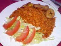 Jollof Rice or Riz Gras. Goes well with fried fish, chicken and beef (or any meat). Can be done vegetarian as well.