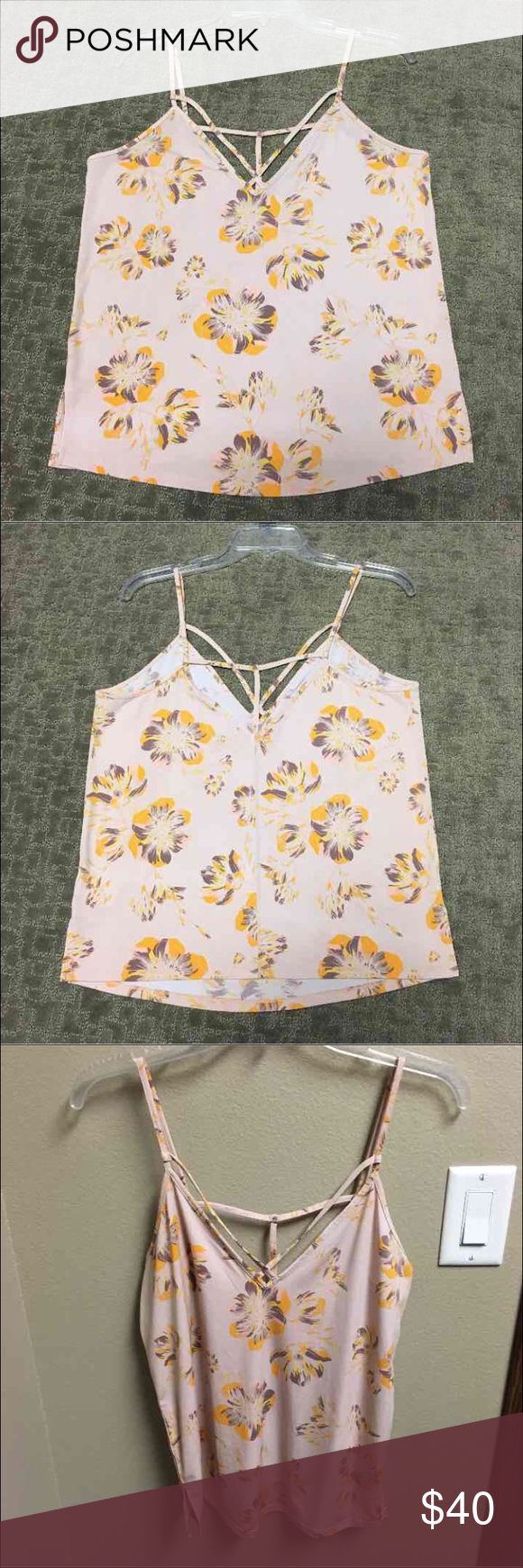 Free people tank top Gorgeous light pink free people strappy tank top. This tank top is in great condition and it is very flowy. It's has purple, yellow, and pink flowers on it and is perfect for spring. It's a size small but could definitely fit bigger. Free People Tops Tank Tops