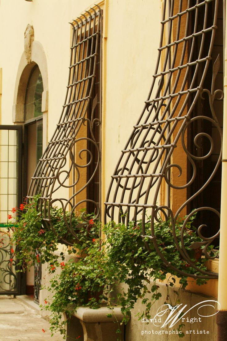 I so love these antique iron window guards in Italy.