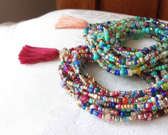 Festival Colors! A long strand of beautiful beads you can wrap around your wrist, ankle or neck. This design includes colorful faceted Jade, Cherry Quartz Glass, Coral Marble, Jasper, various glasses and seed beads. The Tassel is NOT included. A link to order Tassels and Charms is below. I show an optional Raspberry Tassel in the photos.  This is a generous 87 long and will wrap about 12 times on a 7 wrist. Send me note if you need special sizing. I love pairing this one with so many of my…