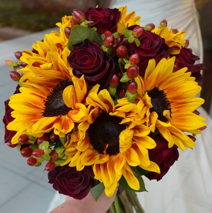 Love maroon with the bright yellow sunflowers for a fall wedding bouquet - roses and hypericum. Really nice!