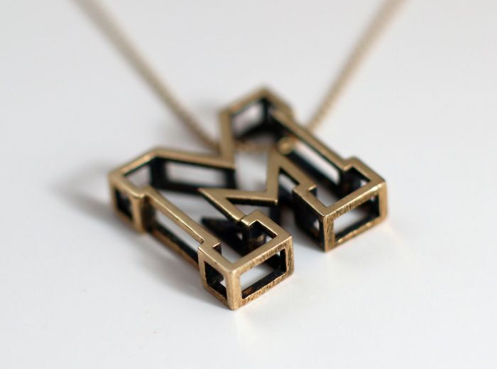 """There are a lot of great words starting with the letter """"M"""", like magnificent, macaroni, mighty, marvelous, mystery, magic, mother...  So this is why I'm pretty sure the letter """"M"""" is just the best of all. If you think so too, you might like this pendant.   The 3d printed Letter M pendant is available in different materials."""