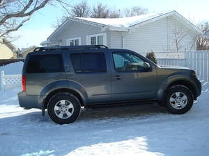 2005 Nissan Pathfinder , This year was my first . I had it in Silver with charcoal Interior in a SE model. Love this truck.
