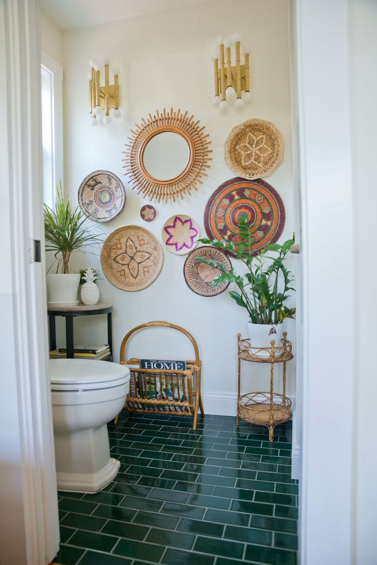 Half bathroom. The magazine holder was found at a garage sale and the wall baskets were found at various places like garage sales, thrift stores, and eBay. The tile is Fireclay Tile. The plant stand was found on Etsy and the hand towels are World Market.