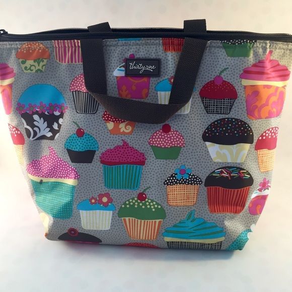 Adorable Thermal Lunch Tote! Adorable Cupcake and Polka Dot Print thermal lunch bag is stylish and large enough to carry lunch for one or two. Features an outside pocket. Thirty One Bags Totes