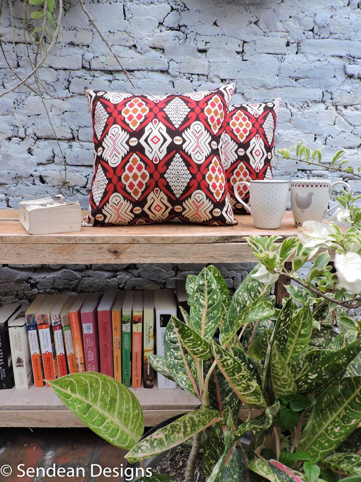 Two red ethnic Batik cushions befriend cups of tea and books. Best morning companion (Product code: RAC5). Like our facebook fanpage Sendean Designs or follow us at instagram @sendeandesigns.