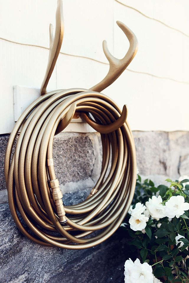 Glamorous garden hoses and hose mounts. Scandinavian designers always come up with the goods don't they? via Garden Glory #MyMoteef #glamorous #hoses