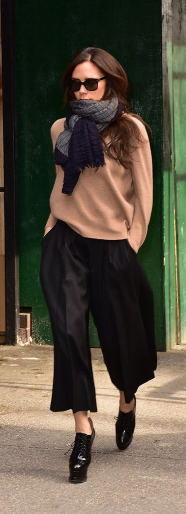 Victoria Beckham wearing Culottes: Paired with cold-weather accessories and a cozy sweater, Victoria's culottes added a sophisticated element to her dressed-up daytime look.