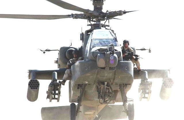 Delta Force/CAG/ACE members ride on an AH-64 Apache [640x417]