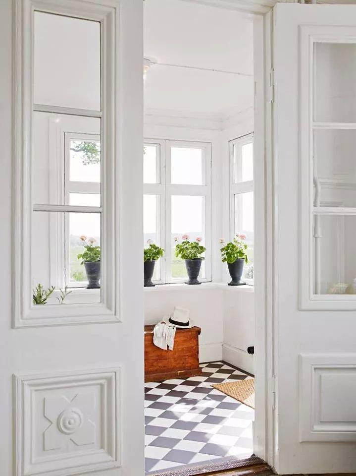 Bright white mudroom/ sun room