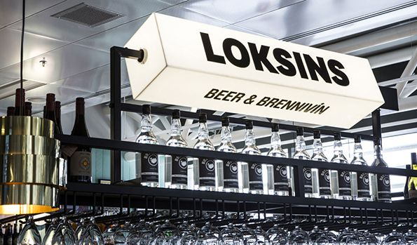 "In another rare foray into the world of commercial interior design, we bring you this rather lovely project from Karlssonwilker, which created the designs for a bar in Keflavík International Airport in Iceland. The consultancy created everything from the name to the signage to the menu graphics, and the concept carries through each beautifully. The name Loksins was chosen, meaning ""finally"" in Icelandic, with the idea that the bar welcomes passengers arriving and departing to and from the…"