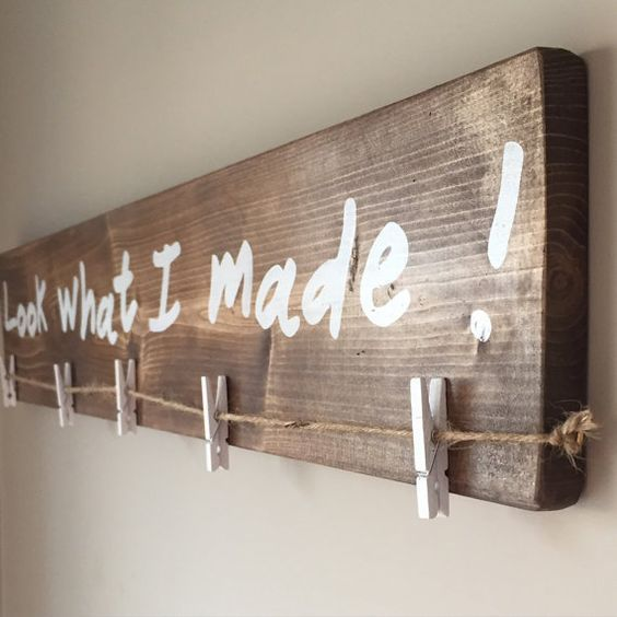 Show off your childrens artwork with this rustic kids art display wood sign. Use the clothespins (5) to display your childs latest and greatest works of art.