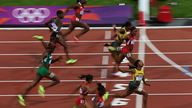 Shelly-Ann Fraser-Pryce of Jamaica crosses the line to win the gold in the Women's 100m Final on Day 8 of the London 2012 Olympic Games at Olympic Stadium. Carmelita Jeter of the U.S. takes silver.