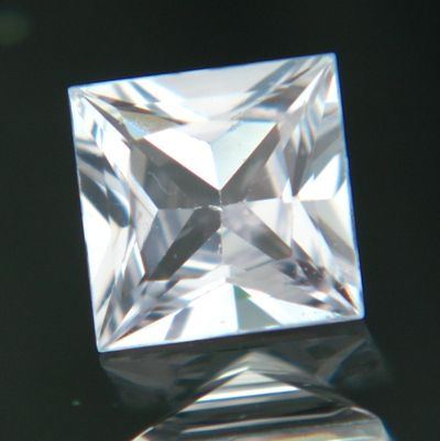 Gemstone: Natural Unheated Sapphire - Carat: 0.99 - Comment: Just a hint of pink separates this sapphire from being colorless. Cut to anger diamonds.  http://wildfishgems.com/inc/sdetail/13553