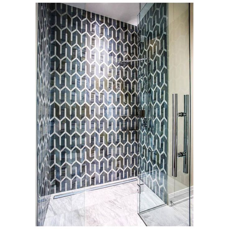 Who wouldn't want to step into this piece of art every morning! Stunning custom mosaic shower.