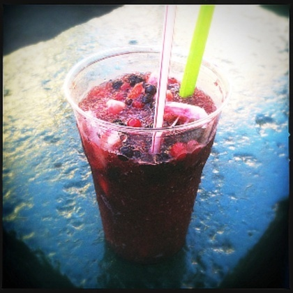 Grattachecca - A Roman specialty... Fresh coconut, cranberries, blueberries and cherry tamarind syrup... A drinkable snow cone... A daily stop...