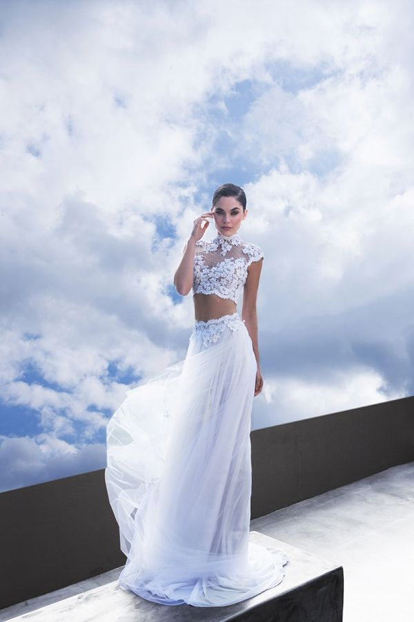 White crop top with tulle slit skirt with a lace waist belt combines with high neck short sleeved bustier
