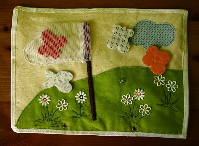 another quiet book idea; unsnap butterflies to put in net. I'd make it with BUGS for a little boy :-)