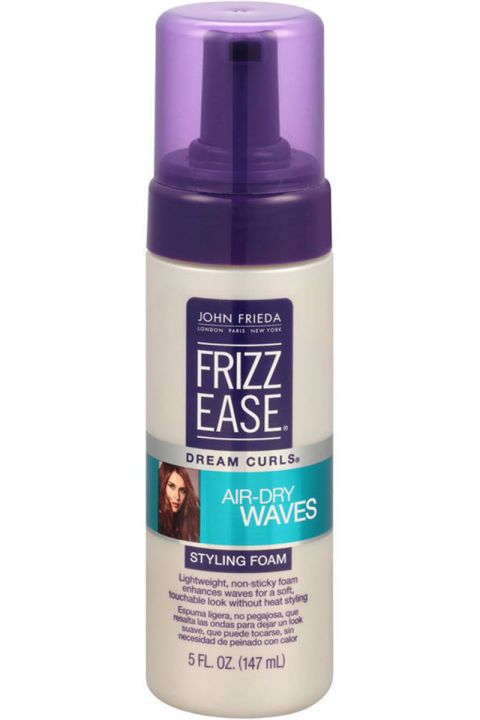 If your hair is more wavy than curly, then this airy foam is your new best friend. Work a blob through wet hair, scrunch a little, and then don't touch it. You'll be left with frizz-free and defined waves. John Frieda Frizz Ease Dream Curls Air Dry Waves Styling Foam, $9.99, ulta.com
