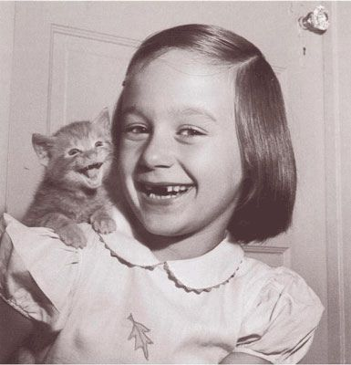 """A happy child and a happy cat"" from buzz feed's 30-strange-but-delightful-vintage-photos-of-animal:"